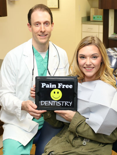Dental Patient and Dr. Nick Calcaterra showing pain free dentistry